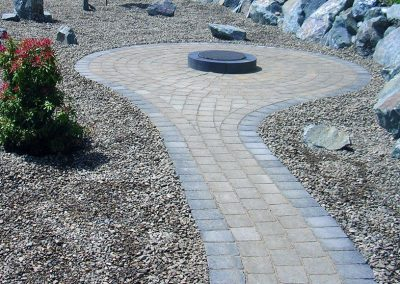 Pathway & patio in pavers with simple fire pit.