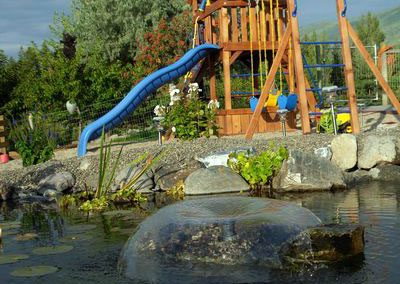 Pond with nice play structure.